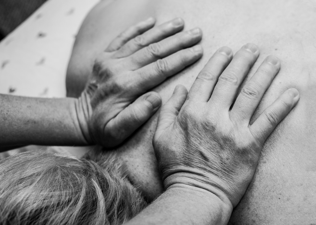 Hands gently massaging back